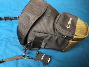 camera strap with holster to make Handling Cameras and Gear Easily
